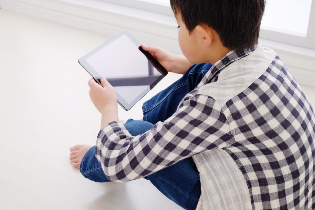 A child having a tablet